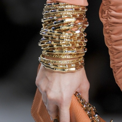 stacked gold bangles